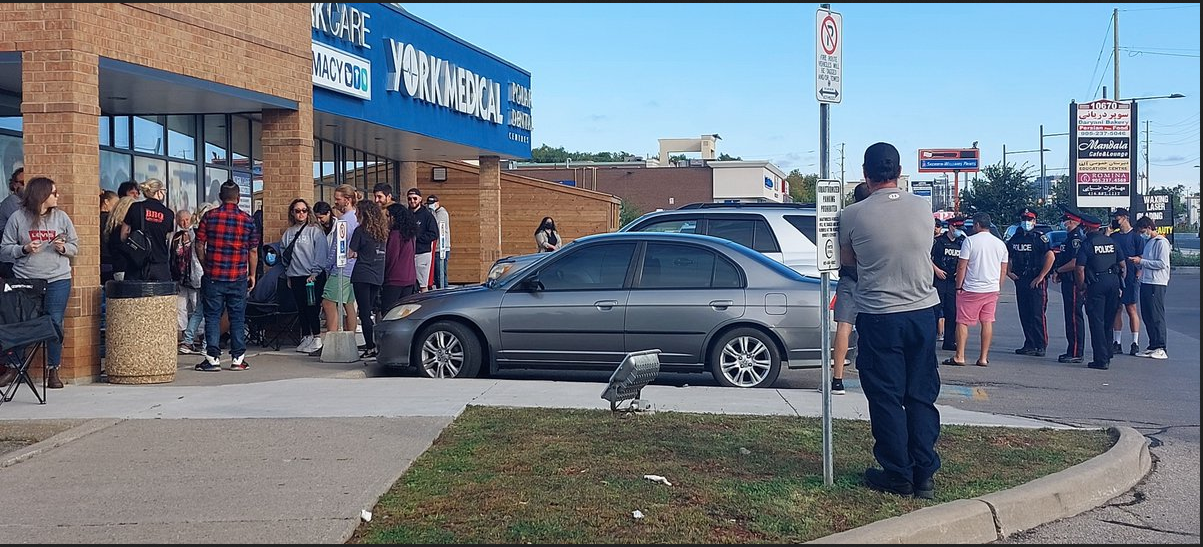 A crowd of people standing outside a York Medical clinic