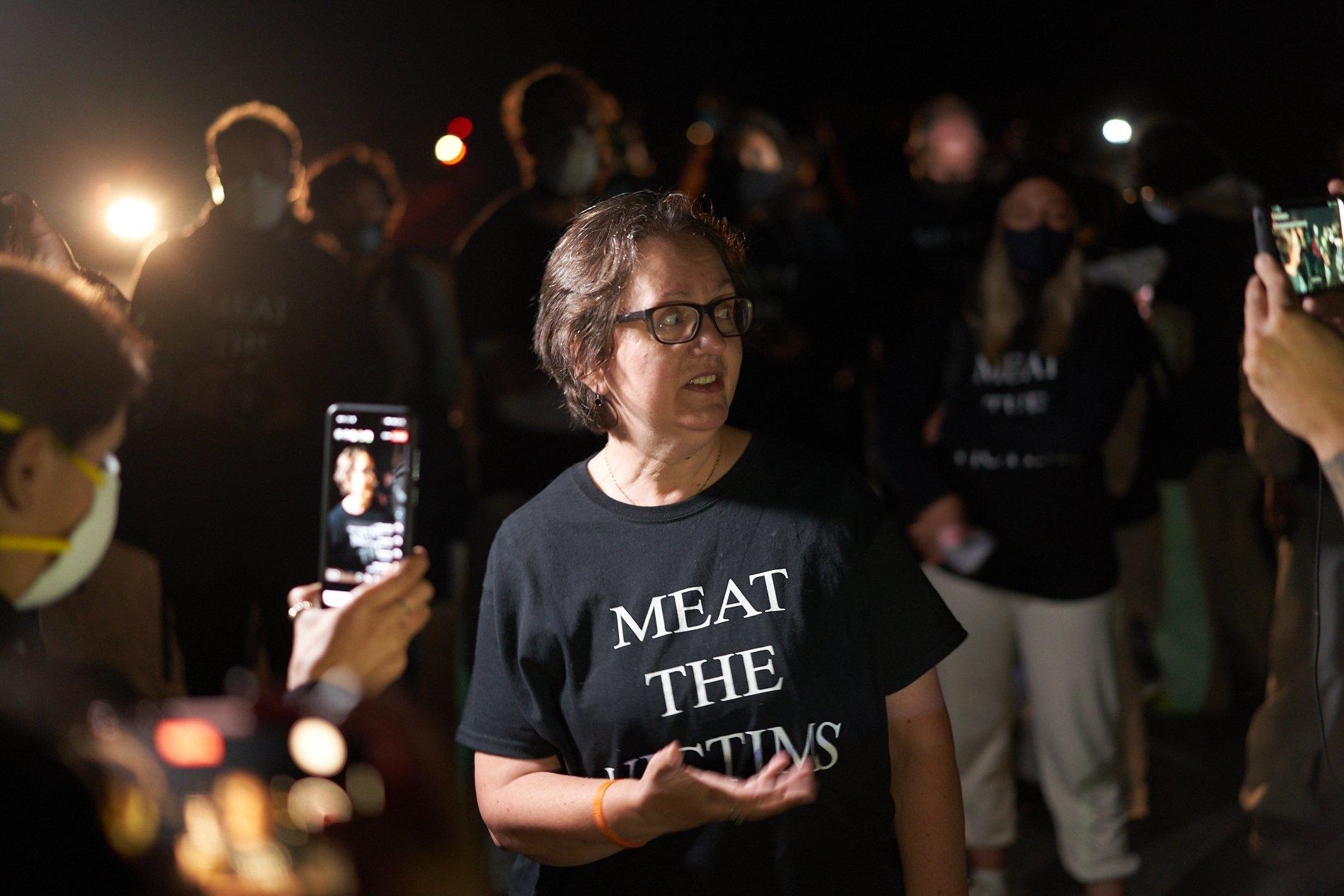 Jenny McQueen stands outside Hybrid Turkey Farm on Oct. 3.
